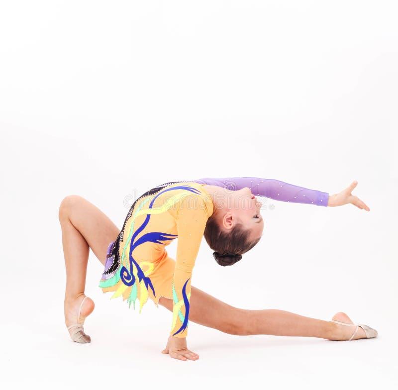 Bella ginnasta flessibile della ragazza immagini stock libere da diritti