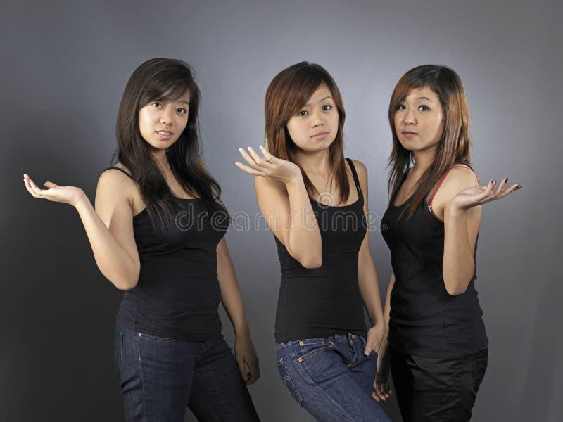 Bella giovane donna asiatica tre fotografie stock libere da diritti