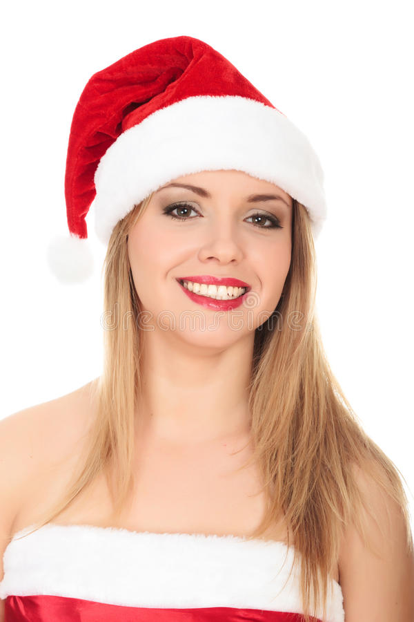 Bella giovane donna in cappello da portare rosso della Santa. fotografia stock libera da diritti
