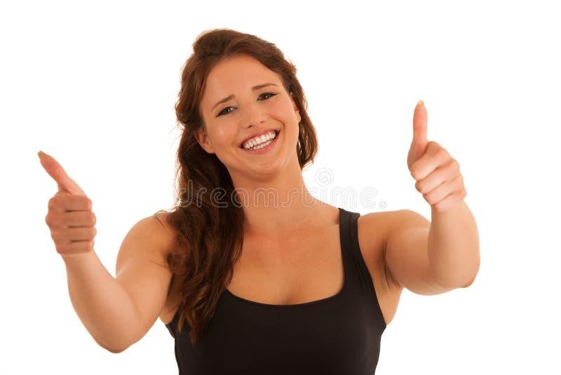 Bella giovane donna castana che gesturing successo con il pollice su io fotografie stock