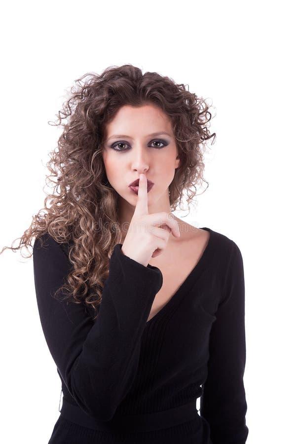 Bella giovane donna che chiede il silenzio fotografie stock