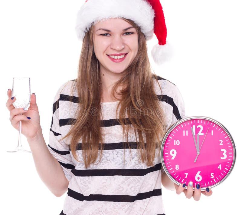 Bella giovane donna con l'orologio ed il vetro di champagne fotografia stock