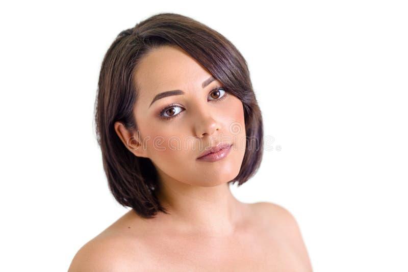 Bella giovane donna con pelle perfetta isolata su bianco fotografia stock