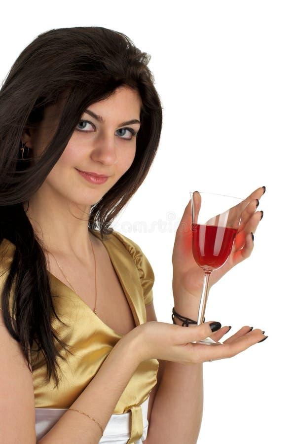 Bella giovane donna con vetro fotografia stock libera da diritti