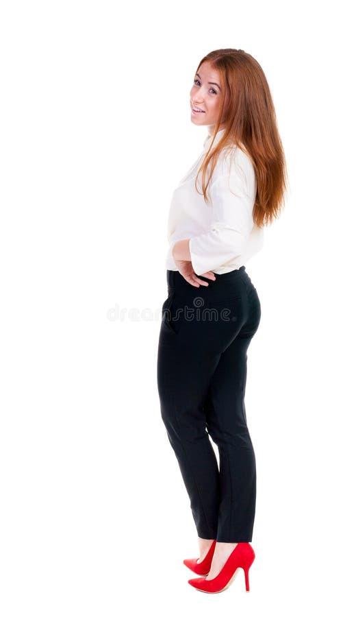 Bella giovane donna di affari che esamina parete immagini stock libere da diritti