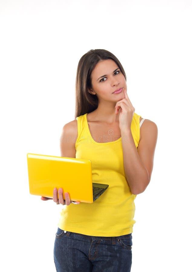 Bella giovane femmina con un computer portatile fotografia stock