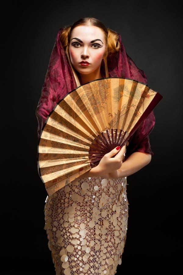 Bella giovane ragazza di geisha fotografia stock libera da diritti