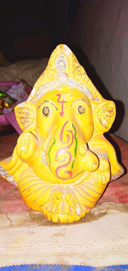 Bella immagine di Ganesh del dio di colore giallo fotografia stock libera da diritti