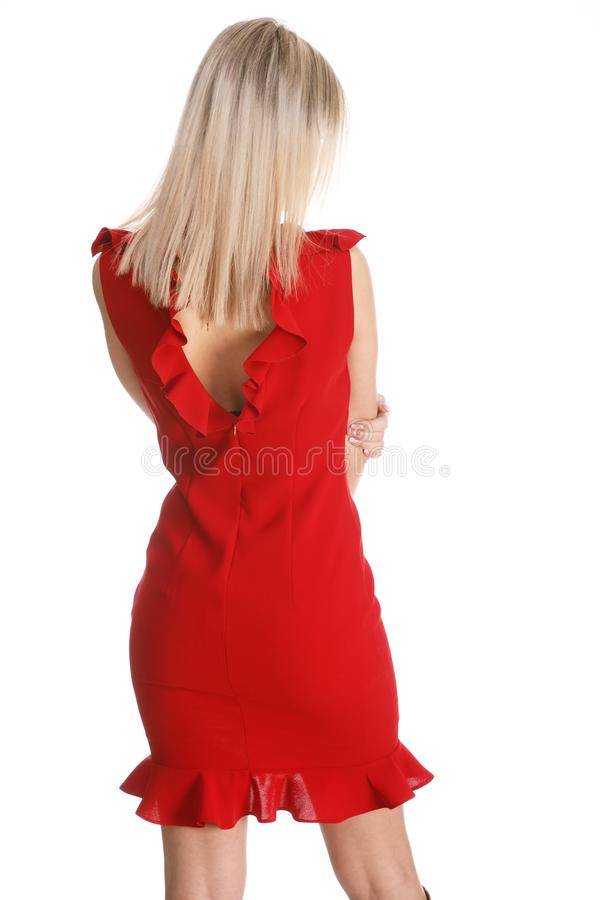 Bella parte posteriore della giovane donna in un vestito sexy rosso immagini stock libere da diritti