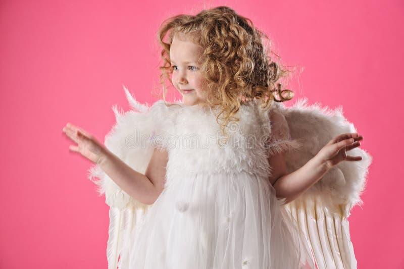 Bella piccola ragazza di angelo i fotografia stock libera da diritti