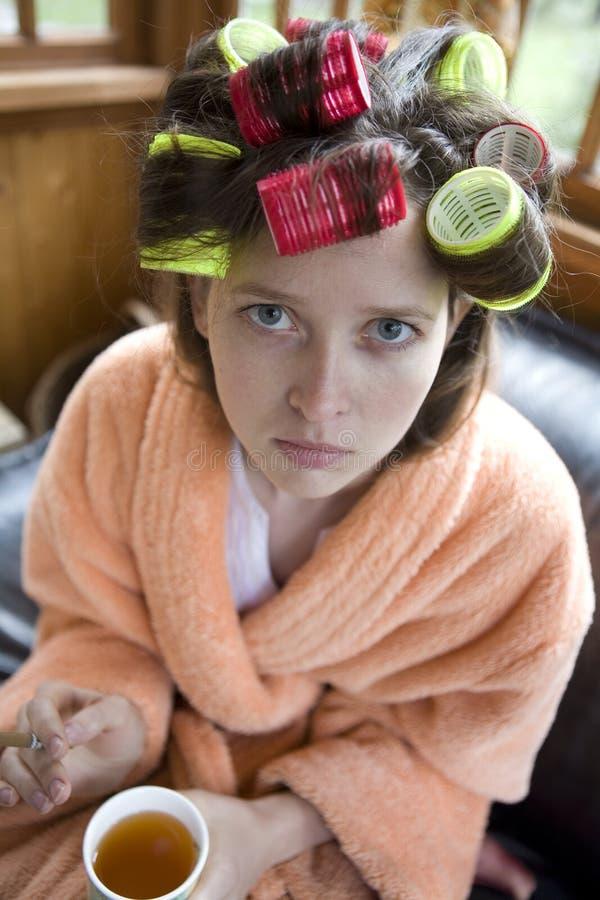 Download Bella ragazza in bigodini. immagine stock. Immagine di abito - 7321863
