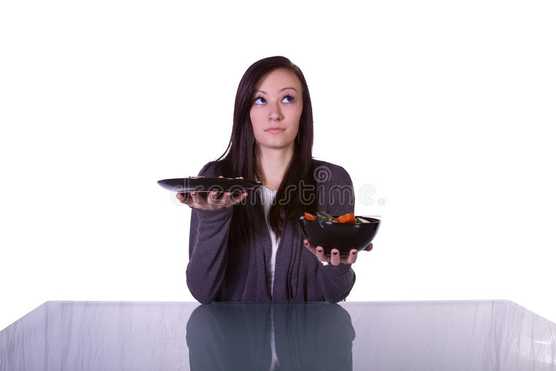 Bella ragazza che decide che cosa mangiare immagini stock libere da diritti