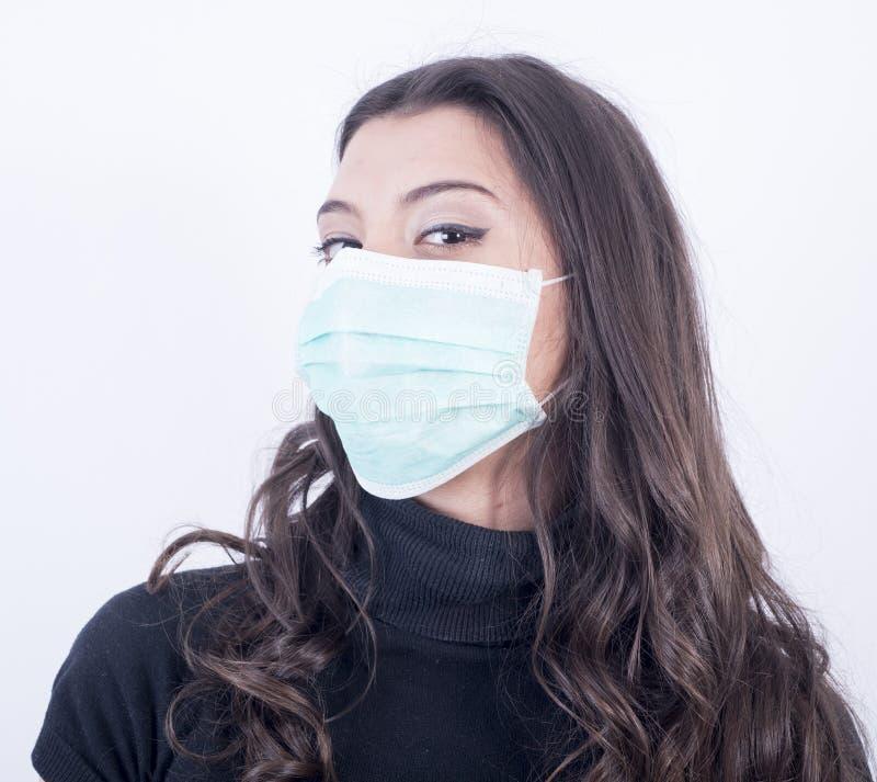 Bella ragazza con la maschera fotografia stock libera da diritti