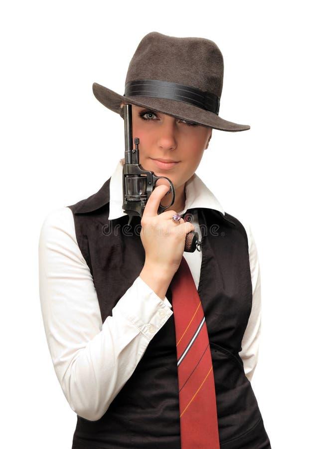 Bella ragazza con la pistola immagine stock libera da diritti