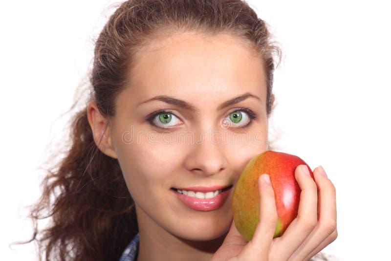 Bella ragazza con una mela fotografia stock