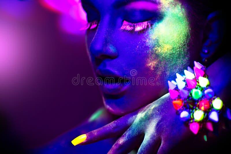 Bella ragazza di modello con trucco fluorescente immagini stock