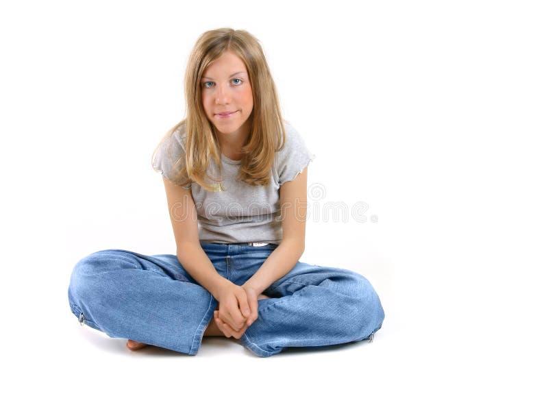 Bella ragazza di seduta fotografia stock