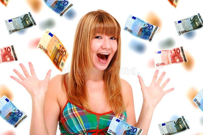 Bella ragazza ed euro soldi. fotografia stock