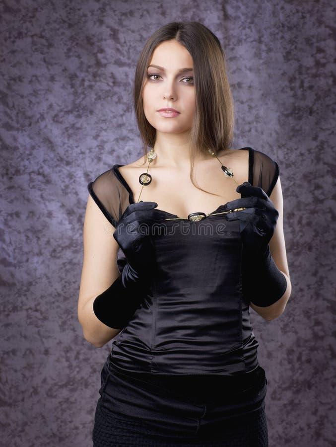 Bella ragazza in guanti immagini stock