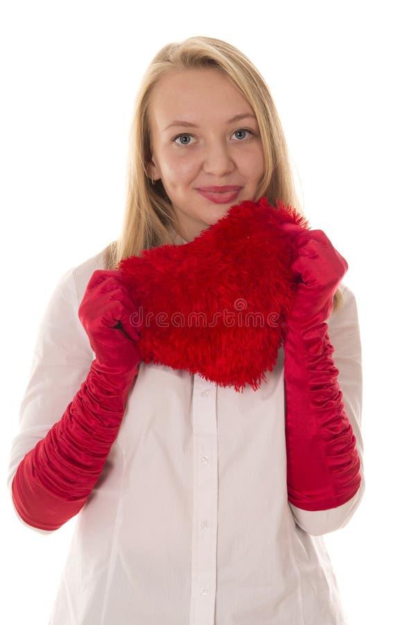 Bella ragazza in guanti rossi fotografia stock
