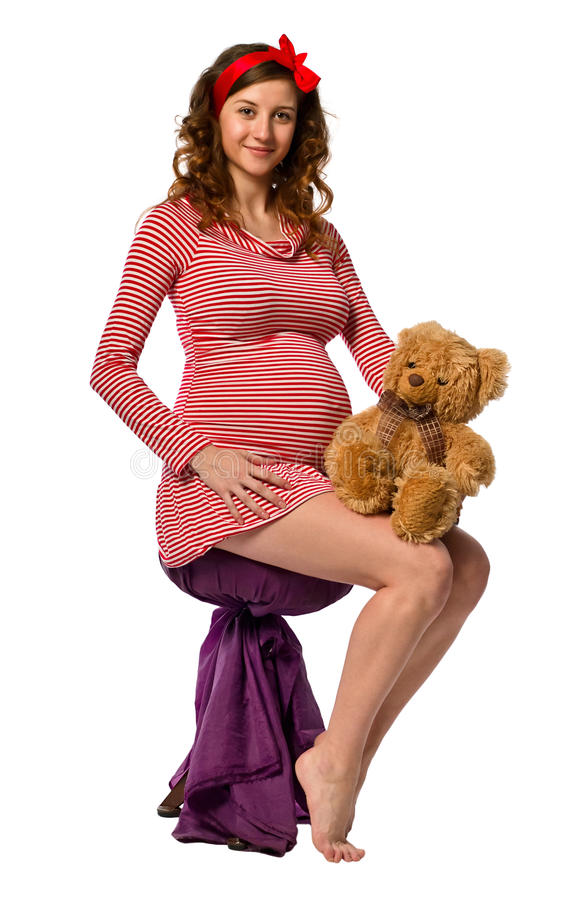 Bella ragazza incinta che abbraccia un giocattolo fotografie stock
