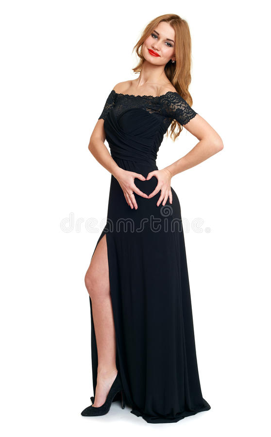 Bella ragazza nel simbolo nero del cuore di manifestazione dell'abito dalla mano, isolata su fondo bianco, sulla festa del biglie fotografia stock