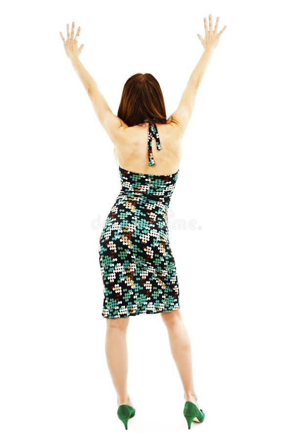 Bella ragazza nel vestito da estate dalla parte posteriore, mani su immagini stock