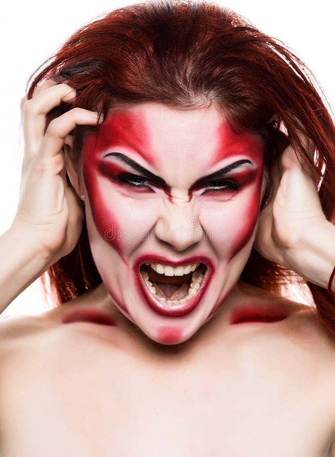 Bella ragazza sexy del diavolo con trucco professionale Progettazione di arte di modo La ragazza di modello attraente in Hallowee fotografia stock