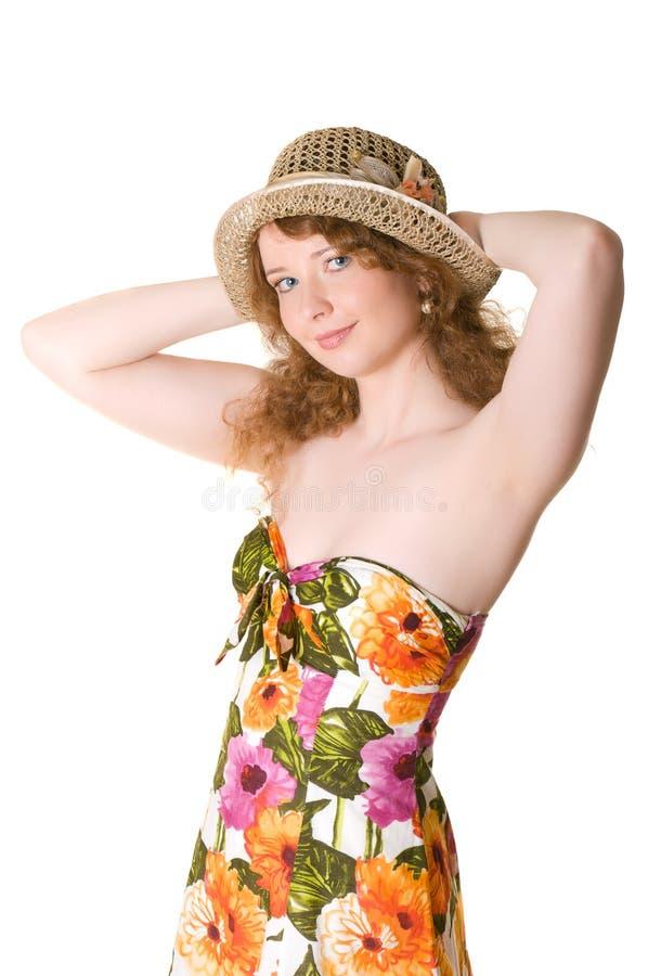 Bella ragazza in un cappello di paglia fotografia stock libera da diritti