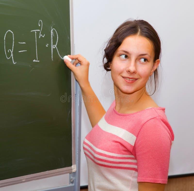 Bella ragazza in un codice categoria di fisica fotografia stock