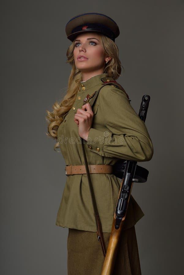 Bella ragazza in uniforme immagine stock