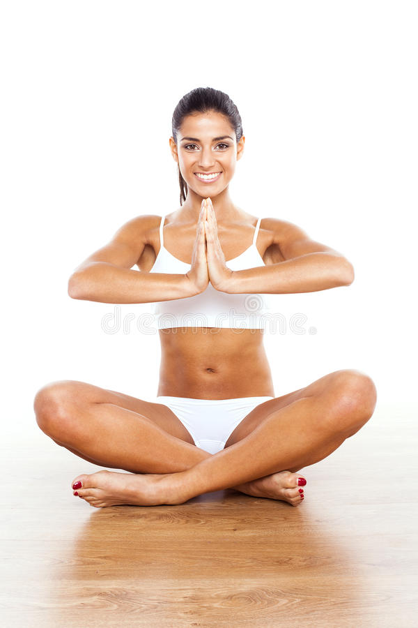 Bella signora Practicing Yoga immagine stock