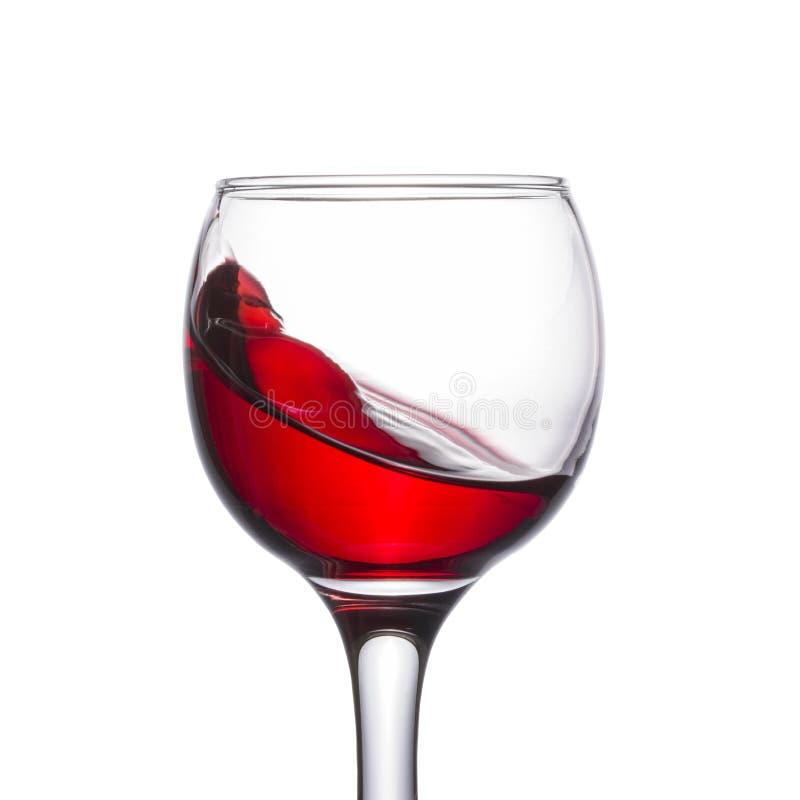 Bella spruzzata di vino in un vetro fotografia stock