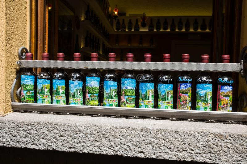Hand painted wine bottles showed outside a restaurant in Bellagio, Italy stock images