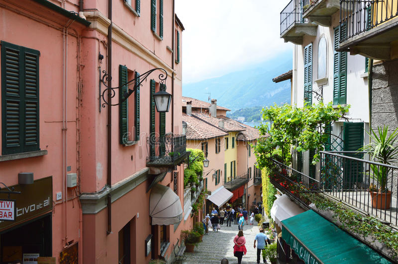 BELLAGIO, ITALY - MAY 14, 2017: tourists in Salita Serbelloni picturesque small town street view in Bellagio, Lake Como, Italy stock photography