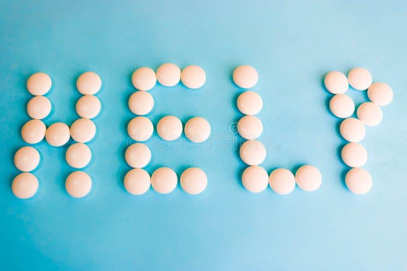 Belle aide d'inscription faite à partir des pilules de rond blanc, des vitamines, des antibiotiques et de l'espace médicaux doux  images libres de droits