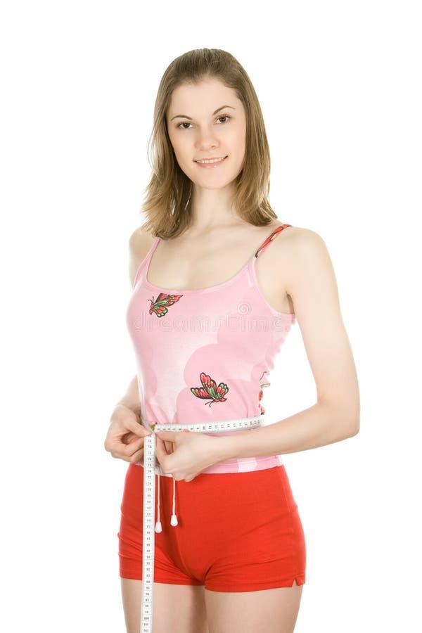 Belle fille avec un ruban métrique photo libre de droits