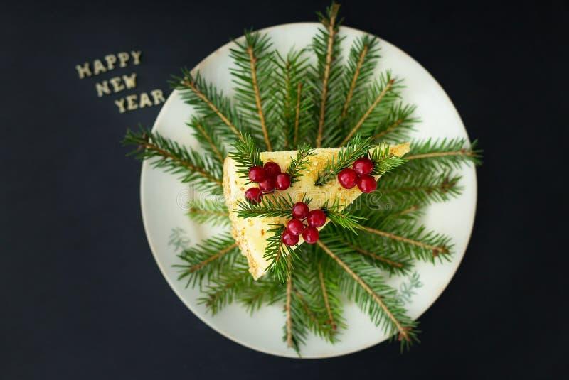 Belle bonne année d'inscription de gâteau de morceau photographie stock