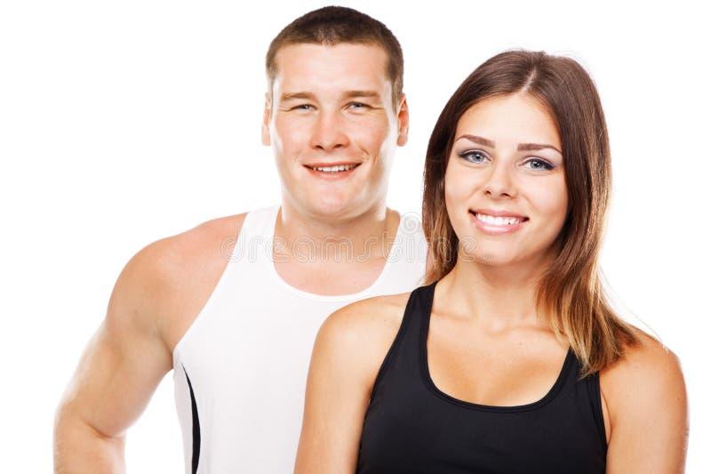 Belle coppie disguardo in attrezzatura di sport fotografie stock libere da diritti