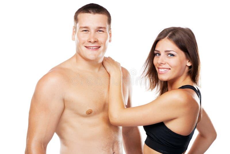 Belle coppie disguardo in attrezzatura di sport fotografia stock