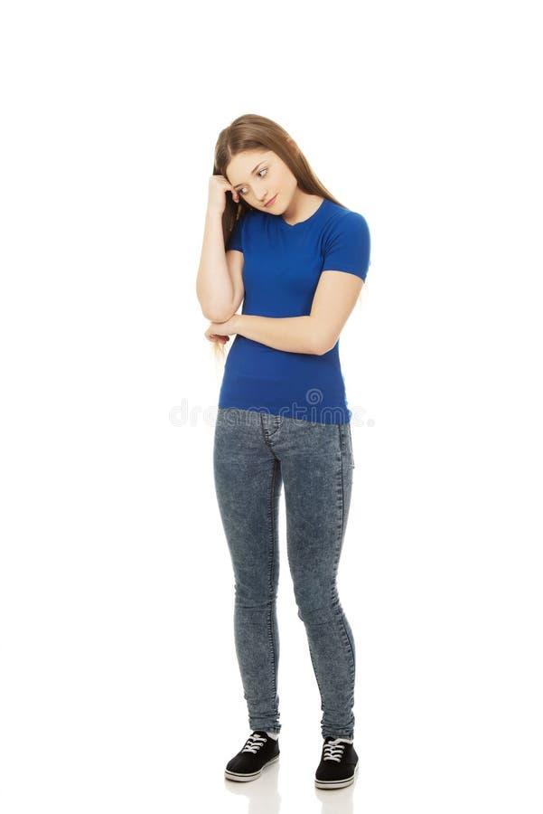 Belle femme adolescente inquiétée image stock