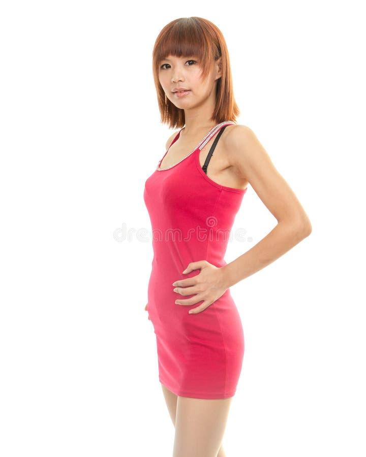 Belle femme asiatique dans la robe rouge photos stock