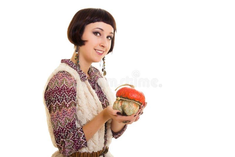 Belle femme avec le potiron. photo stock