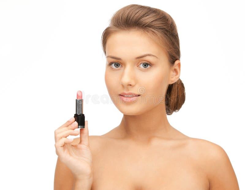 Belle femme avec le rouge à lèvres image libre de droits