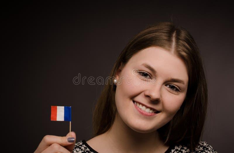 Belle femme avec un drapeau français photos stock