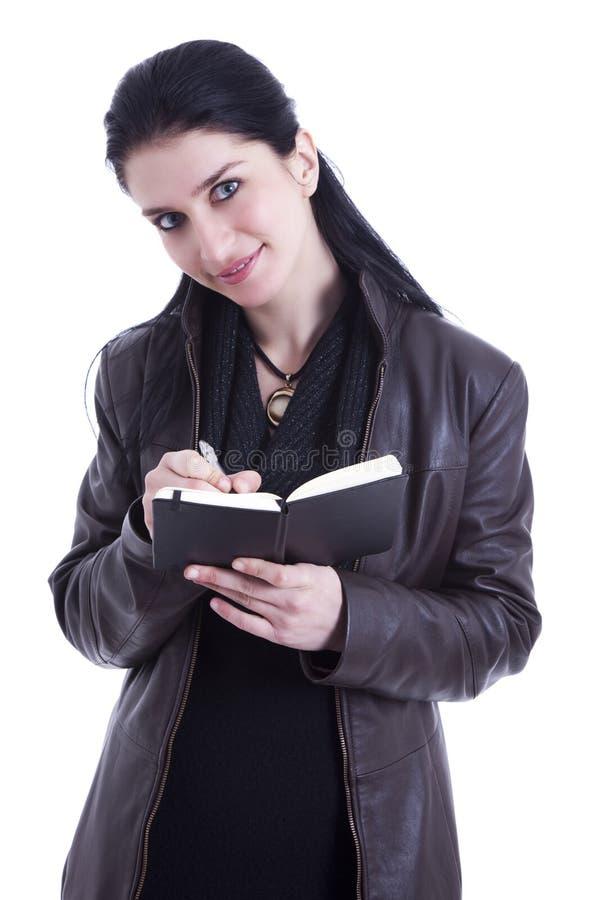 Belle femme d'affaires prenant des notes image libre de droits