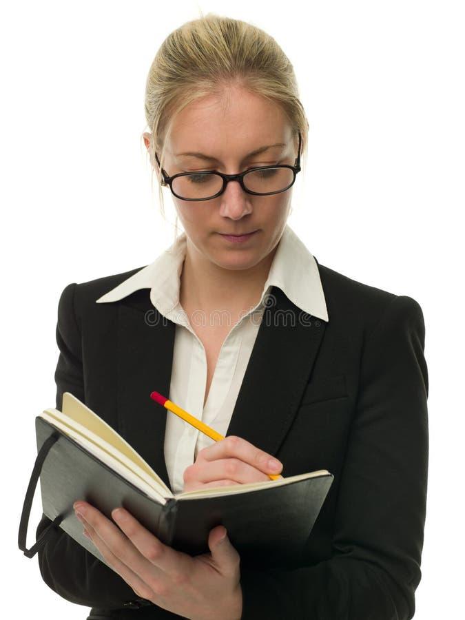 Belle femme d'affaires prenant des notes images libres de droits