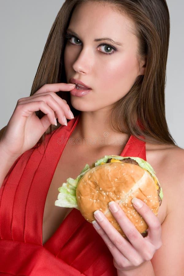 Belle femme d'hamburger images stock