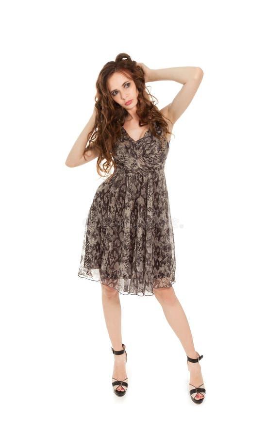 Belle femme de brune dans la robe image stock