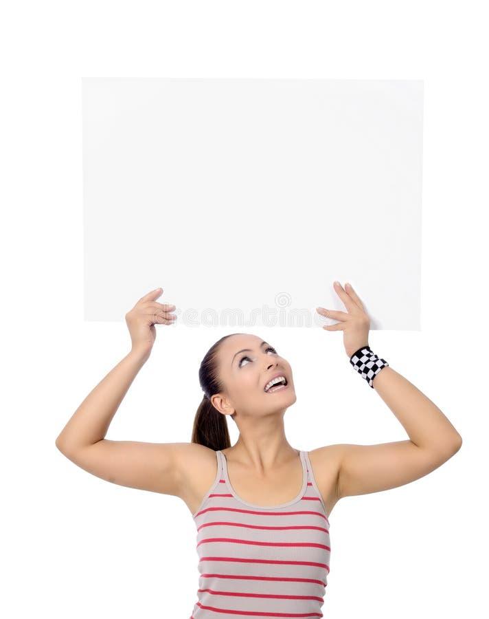 Belle femme de forme physique tenant le signe photographie stock